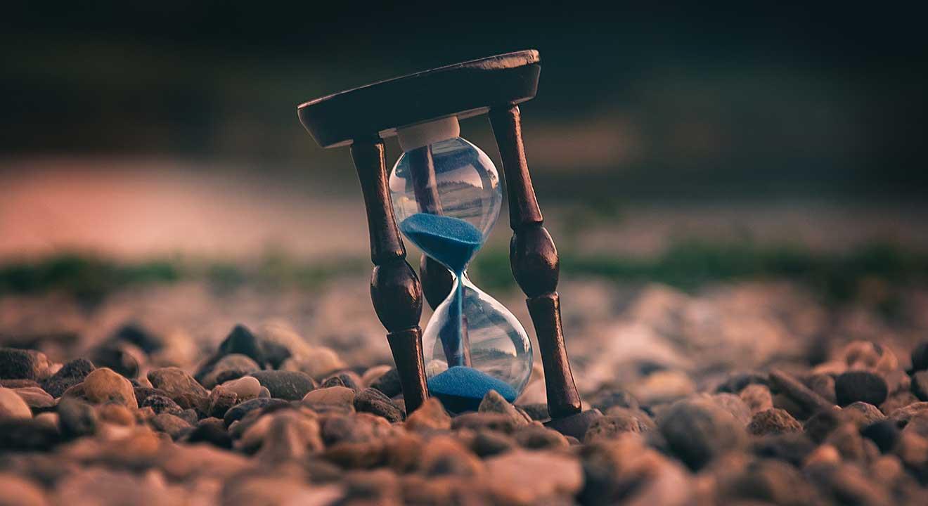 hour glass on rocks