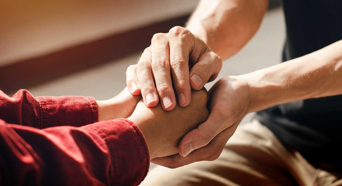 holding hands in encouragement