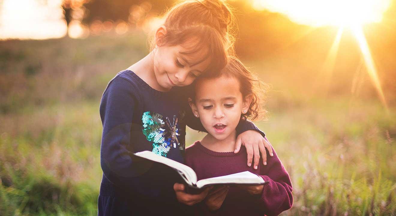 2 children reading Bible